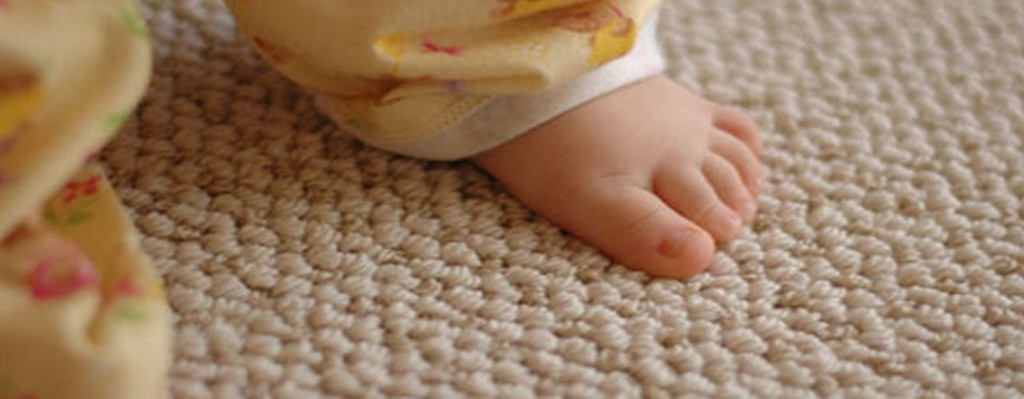 baby foot standing on clean carpet