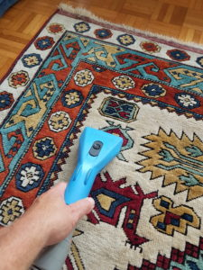 patterned rug being cleaned
