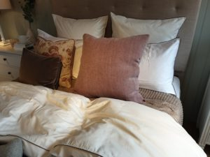 Image of a bed with cushions